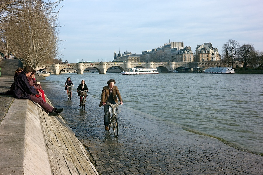 Cycling by the Seine | VOIGTLANDER 25MM / F 4.0 COLOR SKOPAR PANCAKE <br> Click image for more details, Click <b>X</b> on top right of image to close