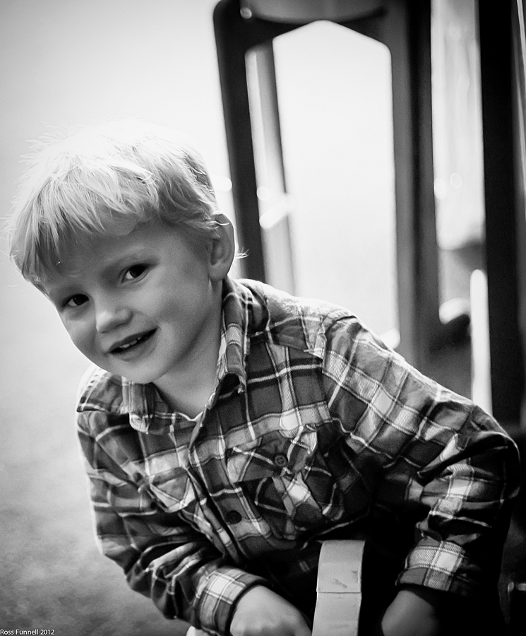 A shy boy | LEICA SUMMICRON 50MM F2 <br> Click image for more details, Click <b>X</b> on top right of image to close