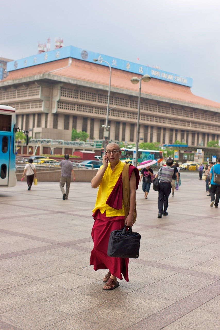 A busy monk geared for business! | LEICA SUMMICRON 35MM F2 ASPH <br> Click image for more details, Click <b>X</b> on top right of image to close