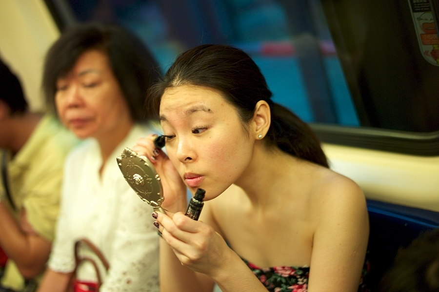 Girl finishing up her make-up on the subway | SUMMILUX-M 1:1.4/50 ASPH <br> Click image for more details, Click <b>X</b> on top right of image to close