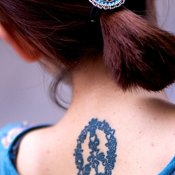 Fashionable tattoo & matching hairclip of today