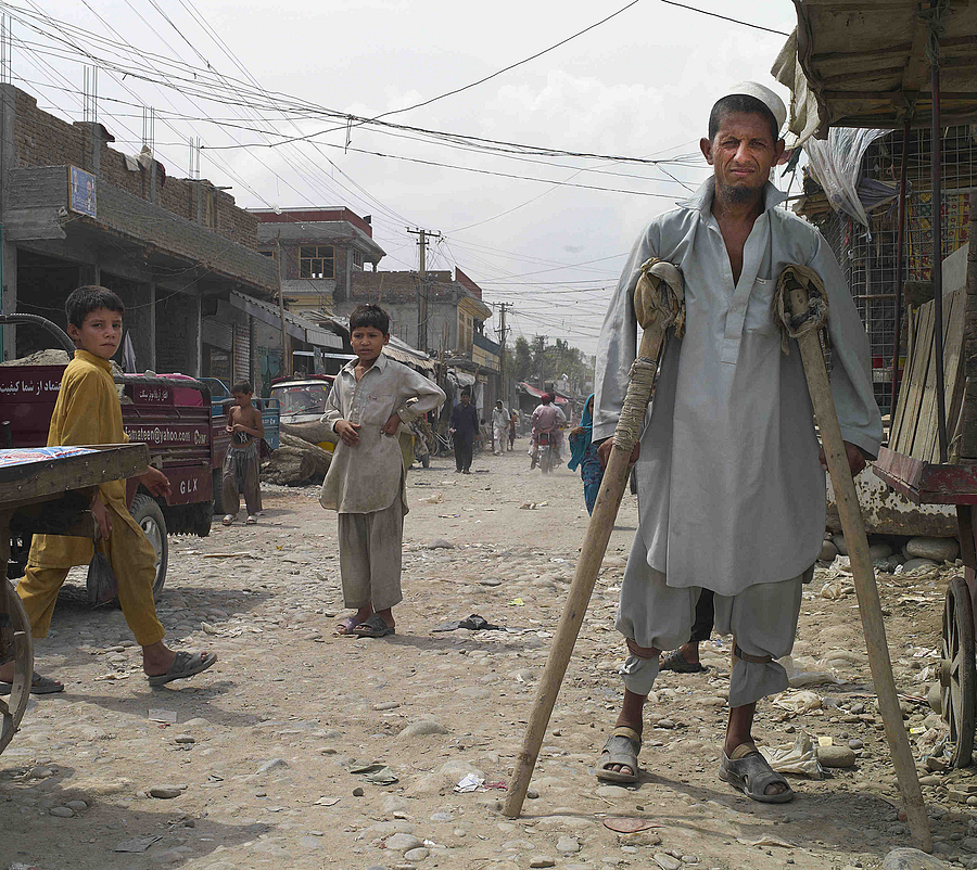 Polio Victim Jalalabad Afghanistan | LEICA SUMMICRON 28MM F2 ASPH <br> Click image for more details, Click <b>X</b> on top right of image to close