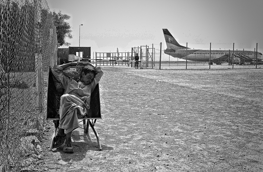 Baggage boy waits Herat Afghanistan | LEICA SUMMICRON 28MM F2 ASPH <br> Click image for more details, Click <b>X</b> on top right of image to close