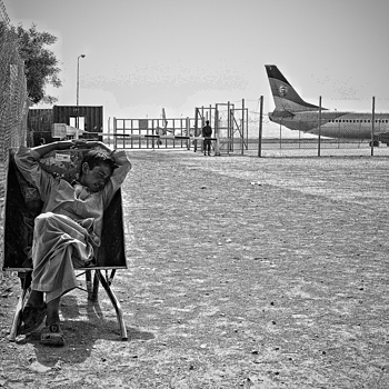 Baggage boy waits Herat Afghanistan | LEICA SUMMICRON 28MM F2 ASPH