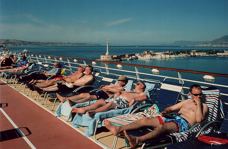 Sun-Seekers on our ship at Messina. | LEICA SUMMILUX 35MM F1.4 <br> Click image for more details, Click <b>X</b> on top right of image to close