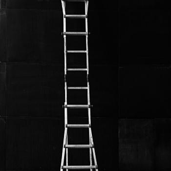 Ladder on black iron wall | LENS MODEL NOT SET <br> Click image for more details, Click <b>X</b> on top right of image to close
