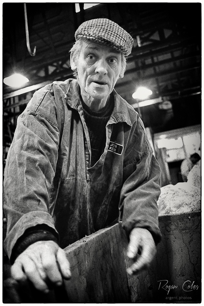 A worker sorting offal at Smithfield Market | LEICA SUMMILUX 35MM F1.4 <br> Click image for more details, Click <b>X</b> on top right of image to close