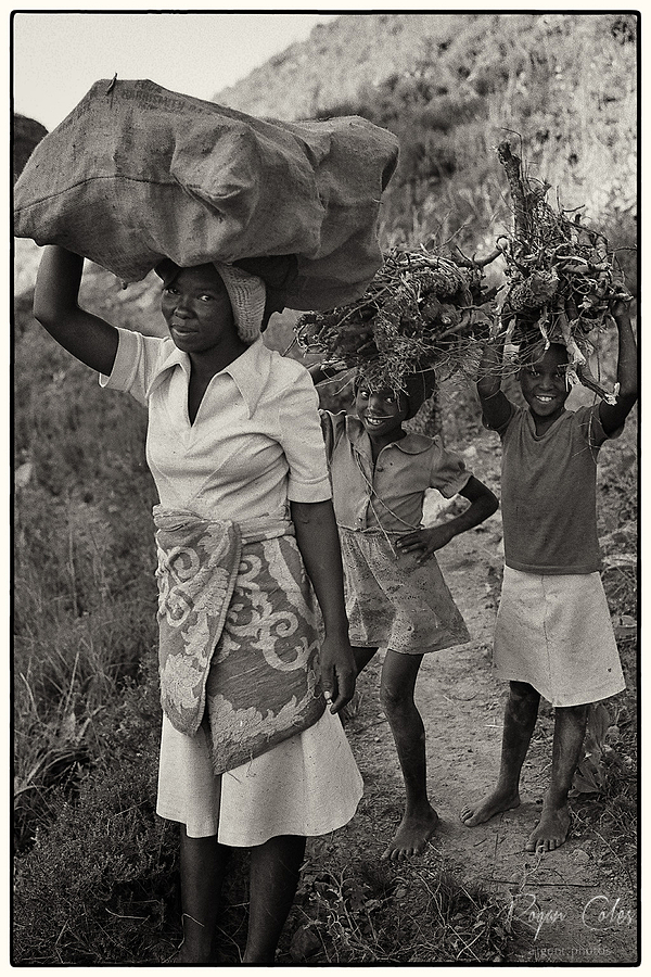 Woman and young girls collecting firewood. | LEICA SUMMICRON 50MM F2 <br> Click image for more details, Click <b>X</b> on top right of image to close