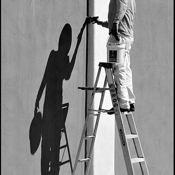 Two men on a ladder | LENS MODEL NOT SET