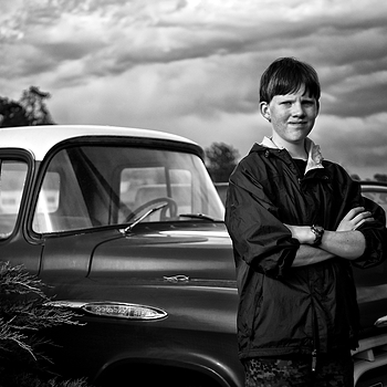 Young Man and an Old Truck | LEICA SUMMICRON 35MM F2. <br> Click image for more details, Click <b>X</b> on top right of image to close