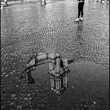 The reflections of Piazza Navona after a rainy night | LENS MODEL NOT SET