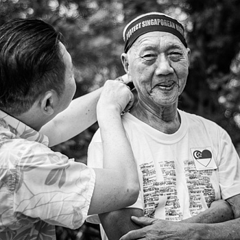 Senior citizen at Labour Day protest Singapore | LEICA SUMMICRON 35MM F2 ASPH <br> Click image for more details, Click <b>X</b> on top right of image to close