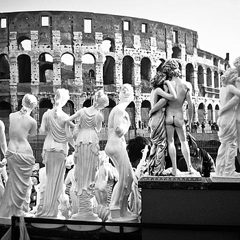 Figurines at colosseum, Rome, Italy