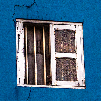 An aging window in Chinatown