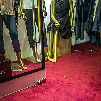 Red-carpeted mannequins