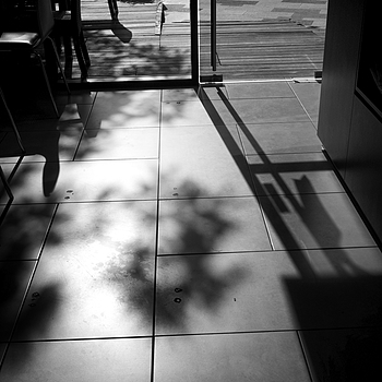 A shadow came into the coffee shop