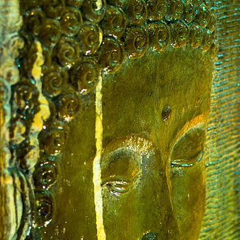 A stained Buddha statue