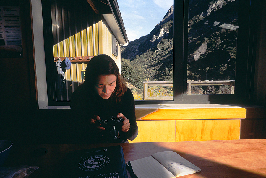 Marion checking her new camera. Dart River Hut, New Zealand. | LEICA ELMAR 24MM F3.8 ASPH <br> Click image for more details, Click <b>X</b> on top right of image to close